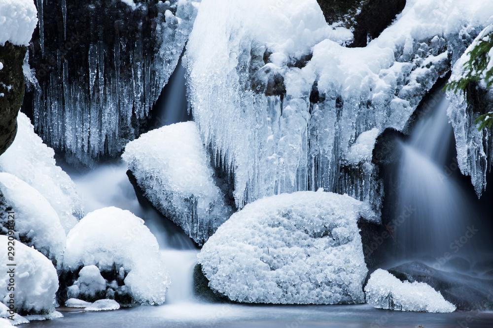 Fototapeta details of a frozen creek in heavy winter