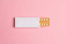Female Oral Contraceptive Pills Blister On Pink Background. Women Contraceptive Hormonal Birth Control Pills.