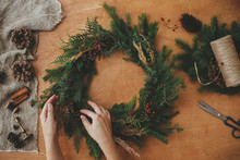 Hands Holding Christmas Wreath...