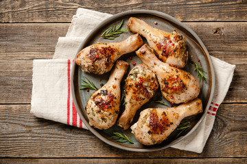 Grilled chicken legs on ceramic plate