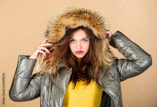Obraz Winter dreaming. woman in padded warm coat. happy winter holidays. beauty in winter clothing. cold season shopping. girl in puffed coat. faux fur fashion. flu and cold. seasonal fashion - fototapety do salonu