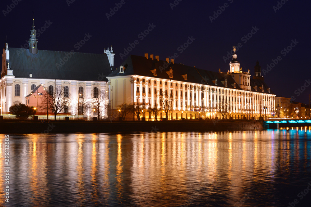 Wroclaw, Poland, Church of the Name Jesus and University by night view from the riverside in the night