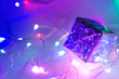 canvas print picture - New Year's gift. Neon colorful background. Blur Close-up.