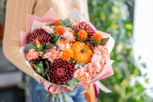 Autumn Bouquet Of Mixed Flowers In Womans Hands. The Work Of The Florist At A Flower Shop. Fresh Cut Flower.