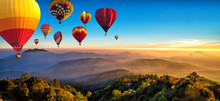 Hot Air Balloons Flying Over Sea Of Mist Awakening In A Beautiful Hills At Sunrise In Chiang Mai, Thailand.