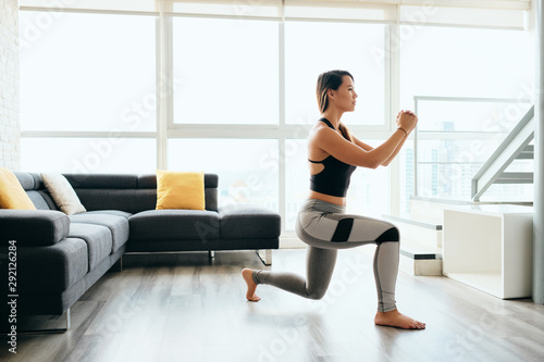 Fotografia, Obraz Adult Woman Training Legs Doing Inverted Lunges Exercise
