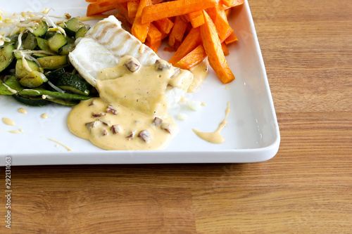 meat and vegetable sandwich white fries. © IDN