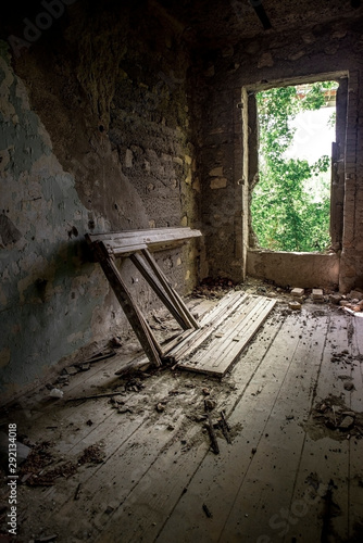 Photo  Abandoned old house with crap inside