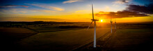 Aerial Of Wind Turbines At Sun...