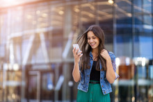 Young Woman With Smartphone In An Urban City Area