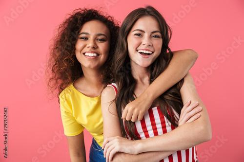 Image of cheerful multinational girls hugging and smiling together at camera Tapéta, Fotótapéta