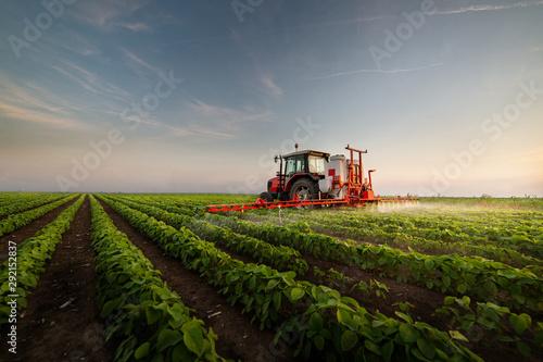 Foto op Plexiglas Grijs Tractor spraying soybean field
