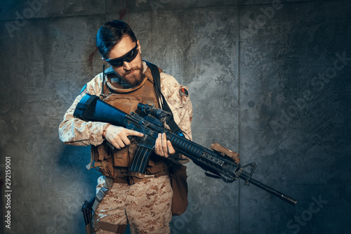 Vászonkép American private military contractor holding rifle