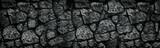 Fototapeta Kamienie - Natural granite stone wall wide texture. Dark rock masonry widescreen gloomy gothic background