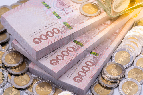 Canvas-taulu Thai baht banknotes and coins. Savings and investing concept