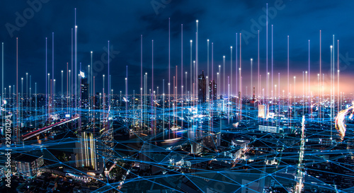 Fototapeta network digital hologram and internet of things on city background.5G network wireless systems. obraz