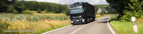 Fotografiet  Truck pulls past the car panorama
