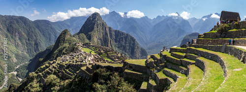 Fototapeta Panoramic view of Machu Picchu ruins in Peru. Behind we can appreciate big and beautiful mountains full of green vegetation. Archaeological site, UNESCO World Heritage obraz