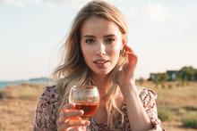 Photo Of Calm Blonde Woman Hol...
