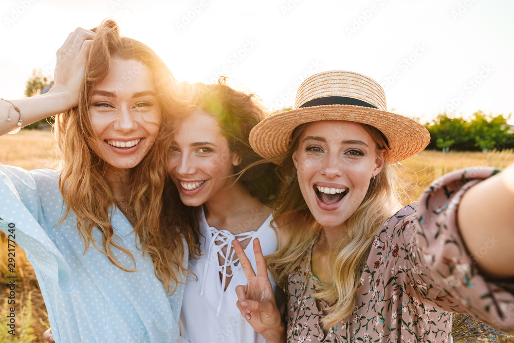 Fototapeta Photo of joyful caucasian women taking selfie photo