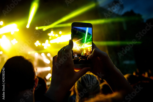 Hand with a smartphone records live music festival, live concert, live concert - 292183240