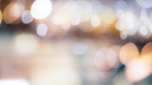 Abstract Blurred Bokeh Light With Warm Tone Color Background Concept.