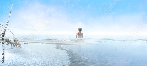 Fotomural  Woman goes into a frozen lake for ice swimming in winter