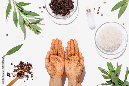 Fotografie, Obraz Female's hands using natural homemade coffee scrub