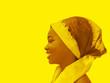Leinwanddruck Bild - Profile view of a beautiful girl wearing a headscarf, yellow background