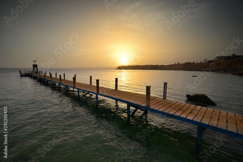 Wooden jetty in Red Sea at sunset. Sharm el sheikh, Egypt