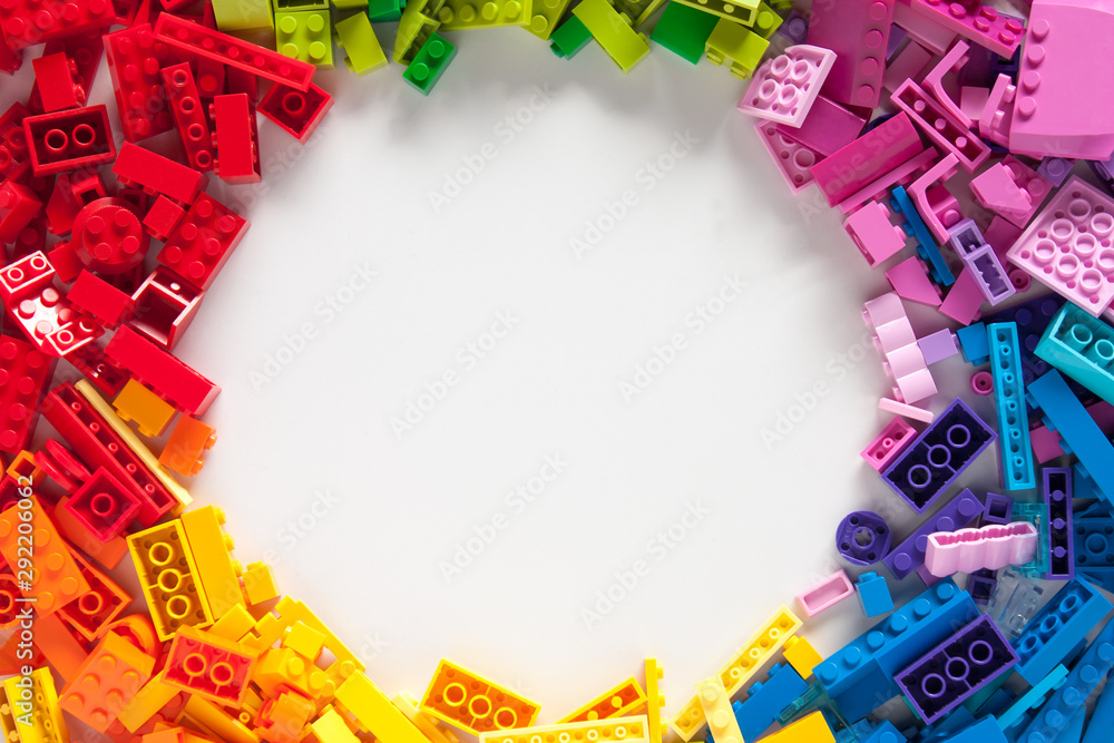 Fototapeta Colored toy bricks with place for your content.