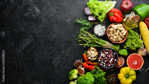 Obraz Organic food. Fresh vegetables and fruits. Top view. Free copy space. - fototapety do salonu