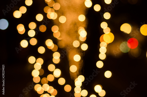 Fototapeta Abstract gold soft blurred bokeh on black background. Shining and blurred circles background. For used wallpaper texture and background with copy space area for a text. obraz na płótnie