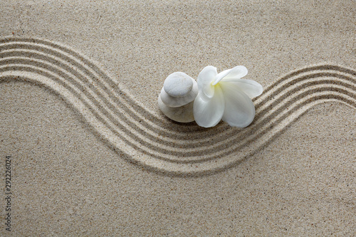 Spa concept. Flower and stones on sand Fototapete