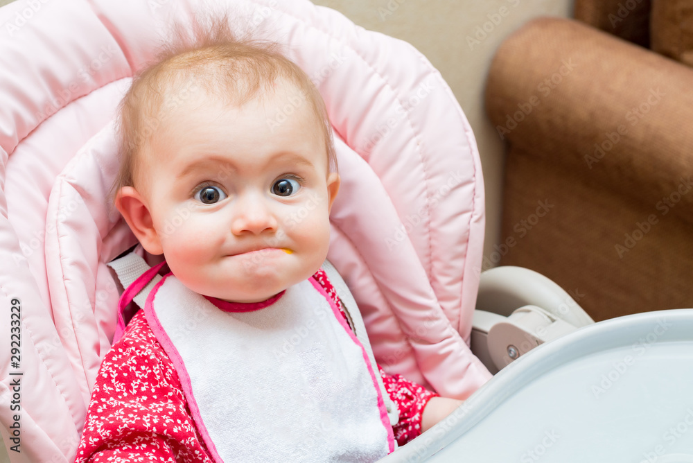 Fototapety, obrazy: Funny baby girl while being fed in her pram