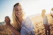 canvas print picture - Beautiful girls in a summer day having fun on the beach, selective focus.