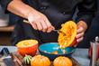 canvas print picture - Chefkoch schneiden frische und leckere Hokkaido Kürbise  zum Kochen von Suppe