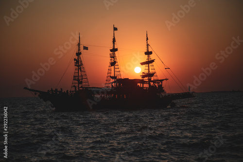 An old Greek galleon view from the Aegean sea during sunset