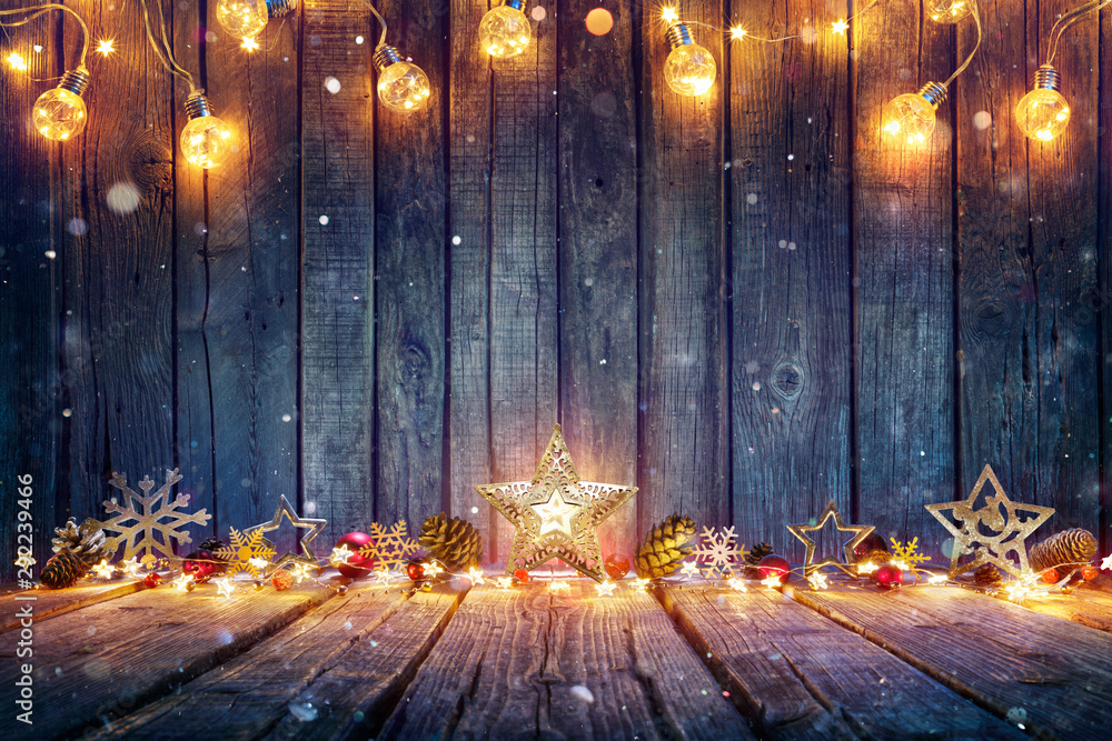 Fototapeta Christmas Decoration With Stars And String Lights On Rustic Wooden Table
