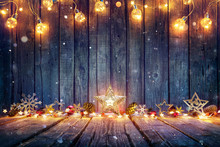 Christmas Decoration With Stars And String Lights On Rustic Wooden Table