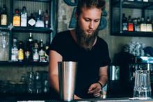 Barman Preparing A Mojito In A...