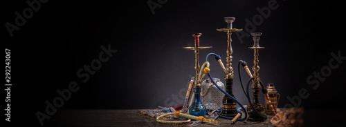 Fototapeta Rustic handmade hookah and arabic tea for relaxation in a dark moody room, rustic decoration, smoke and shisha components obraz