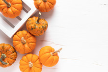 Small Decorative Pumpkins On W...
