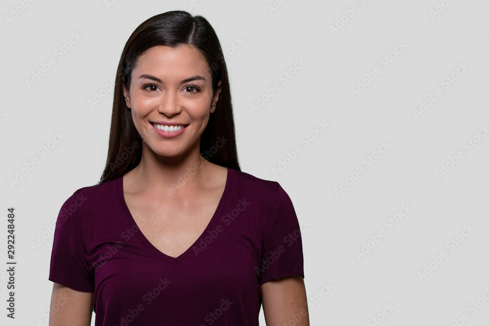 Fototapeta Commercial headshot advertising portrait of a beautiful young asian american brunette woman with perfect white teeth smile