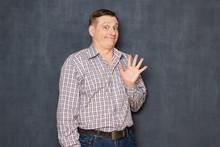 Portrait Of Happy Friendly Funny Man Waving Hand, Saying Hello