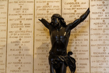 Ablain-Saint-Nazaire, France. 2019/9/14. Plaques With Names Of Soldiers Fallen In WW I. Broken Statue Of Jesus In Front Of Them. Church Of Notre-Dame-de-Lorette At Memorial Of WW I (1914-1918).