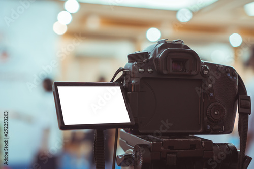 Obraz na plátne Video or professional digital dslr with blank lcd on tripod for camera recording taking photograph in production house or convention hall in live streaming event, media meeting  broadcast equipment