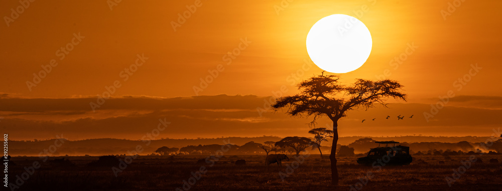 Fototapeta Orange Sunset Safari Vehicle Horizontal Web Banner