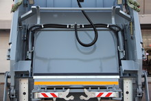 New Gray Refuse Truck Rear View Close Up, City Cleaning