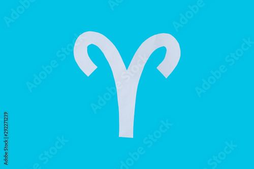 paper cut horoscope sign Taurus isolated on a blue background - 292271239